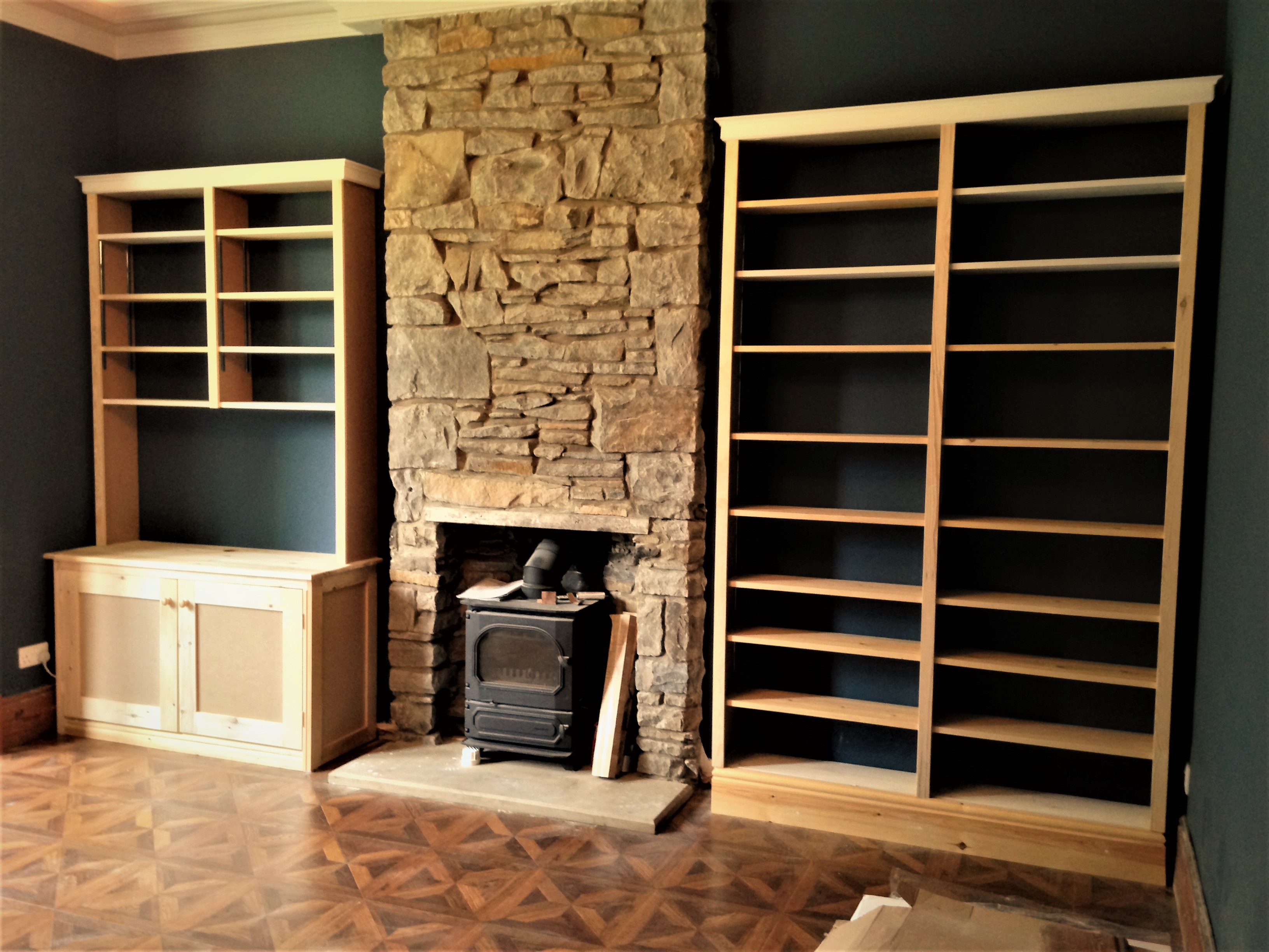 Custom shelving to slot next to a grand fireplace.